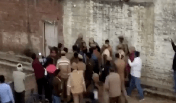 Hostage taker's wife beaten to death by local mob