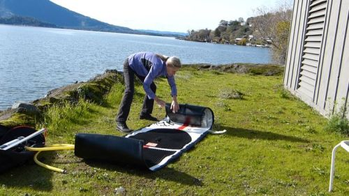 Unrolling the paddle board