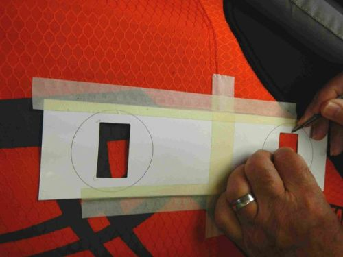 Taping the template into position