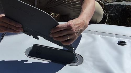 Attaching the tracking fin.