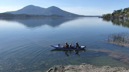 AquaGlide Columbia XP Tandem on the water paddled with three