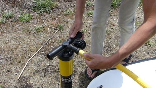 Attaching the gauge to the pump.