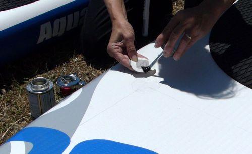 Applying the vinyl cement.