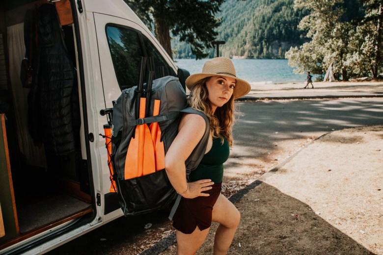 Van Life Crystal wearing the Tahe Beach LP2 Inflatable Kayak Bag