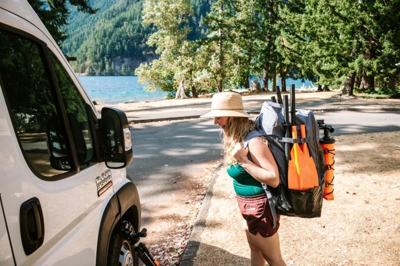 Van Life Crystal Wearing the Tahe Beach LP2 Inflatable Kayak from Airkayaks