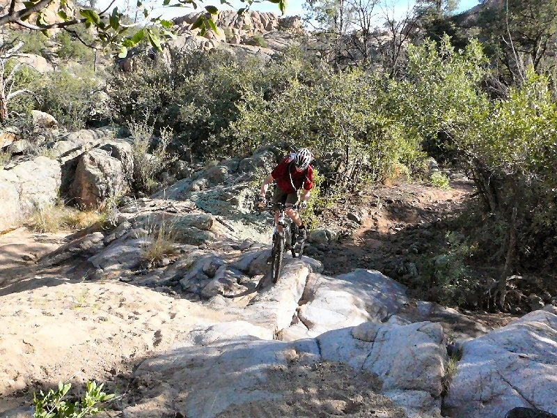 Dave crossing one of the smooth granite creek bottoms.