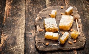 Fresh honey with almonds.