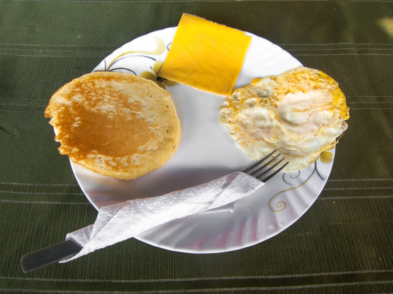 Pancake and fried egg for breakfast