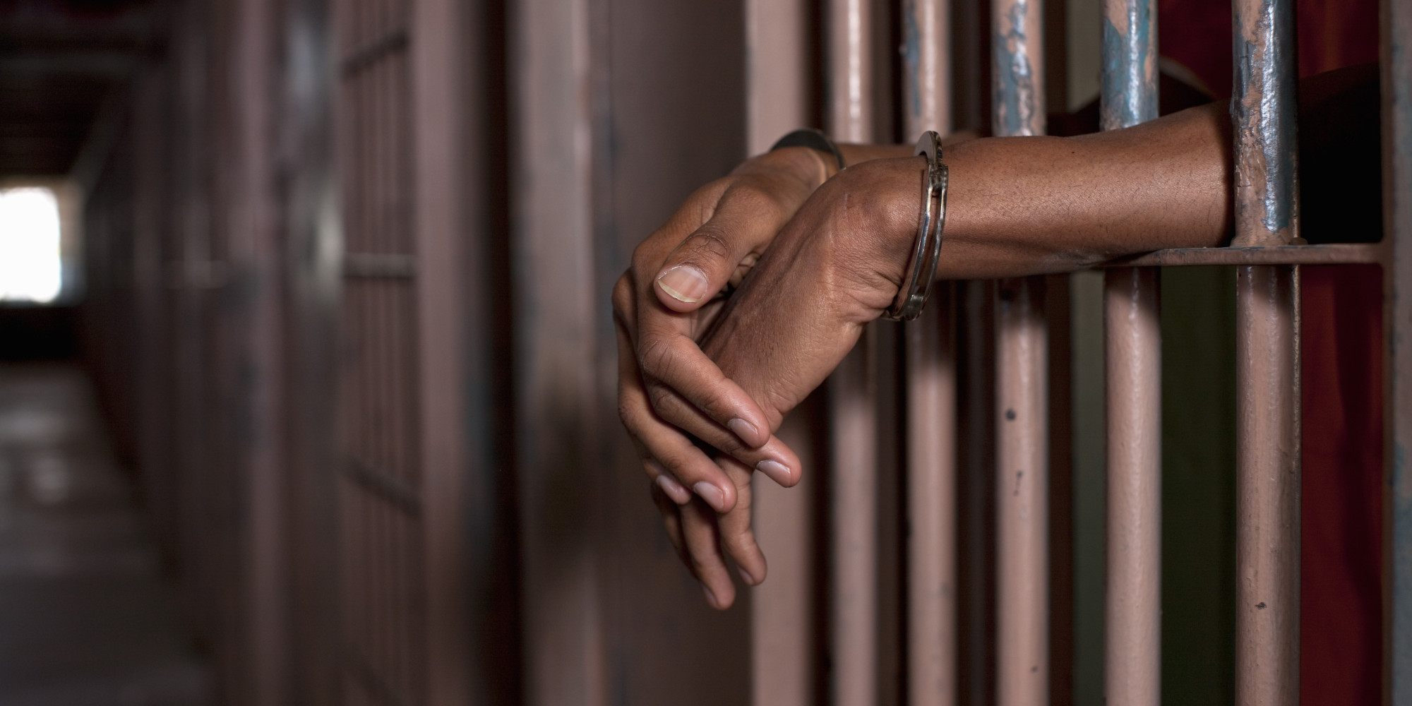Image result for black man behind bars pictures