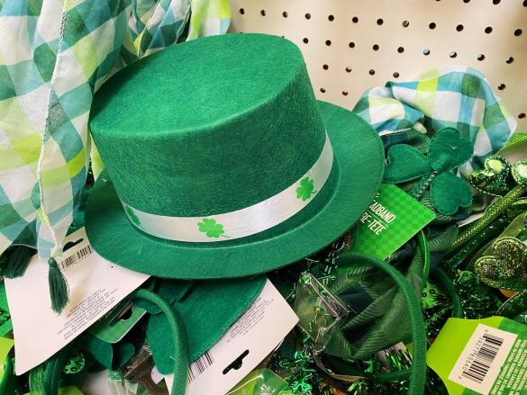 A green hat and green accessories.