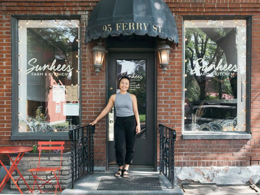 Jinah Kim of Sunhee's Farm & Kitchen stands in front of her restaurant