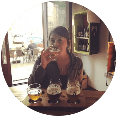 A photo of Gabby Fisher drinking at a beer tasting.