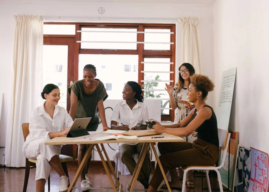 A group of women having a meeting in an office.