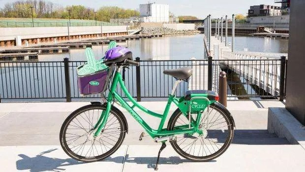 A CDTA bike is parked on a bridge over a body of water.