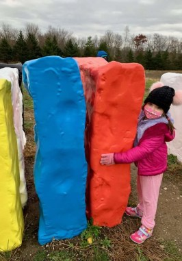 Child with sculpture at Art Omi