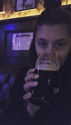 Gabby drinking a Guinness in Dublin