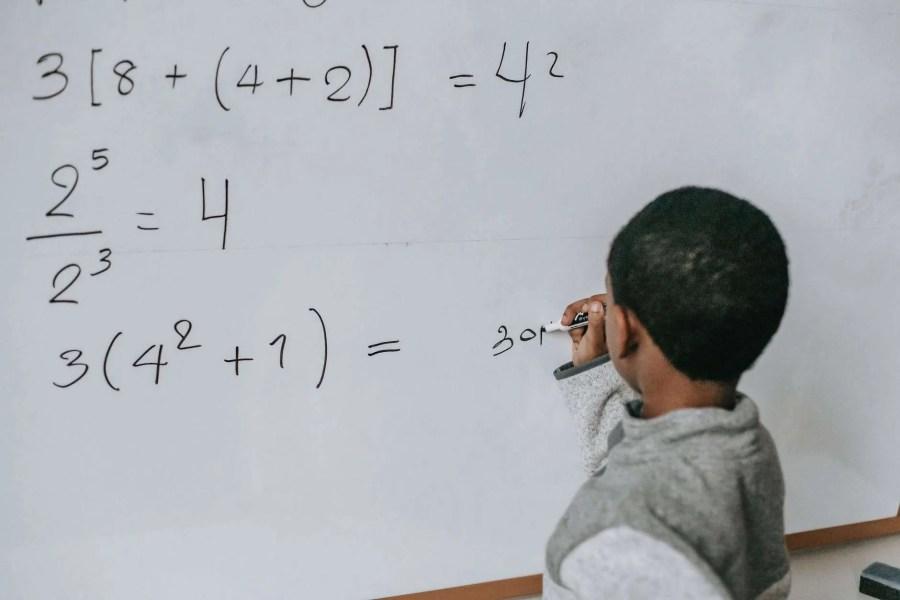 Boy at whiteboard