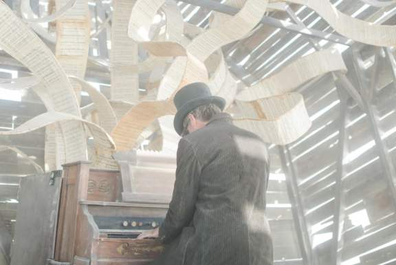 "Mad Hatter Playing an Organ at ""Church Trap"""