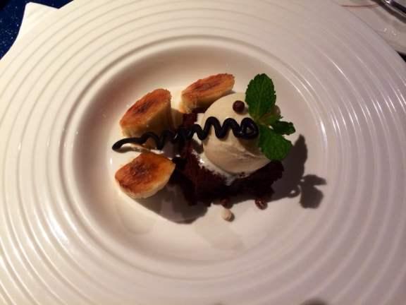 Chocolate Cake With Vanilla Ice Cream and Carmelized Bananas