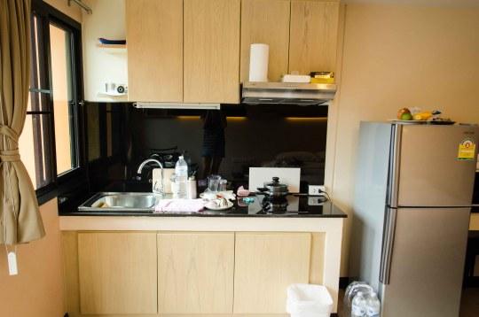 Kitchen with Sink, Range, and Medium sized Refridgerator (not shown, Microwave)