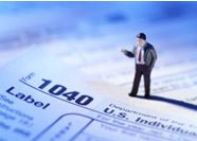 1040 Tax Return with Small Man Figure on It