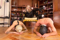 This image is fucking iconic. A male and female sub, each collared and leashed, heads bowed in supplication before my throne... my bootheels resting on the back of the male slave as I look into the camera smirking. This makes me a little wet, even. My power is manifested in their submission.