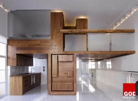 Hogarth Architects transformed another large one-room flat in London into a stylish apartment using a wood insert that creates a separated kitchen and loft. It�s essentially one big piece of furniture custom-made for the space.