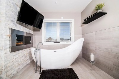 Astonishing and cozy bathrooms design ideas with fireplace 11