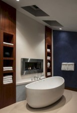 Astonishing and cozy bathrooms design ideas with fireplace 15
