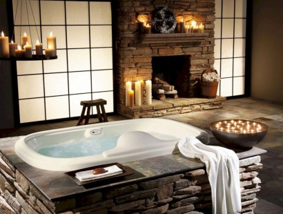 Astonishing and cozy bathrooms design ideas with fireplace 20