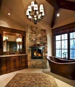 Astonishing and cozy bathrooms design ideas with fireplace 21
