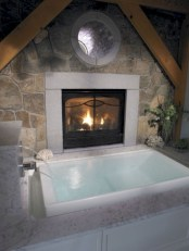 Astonishing and cozy bathrooms design ideas with fireplace 26