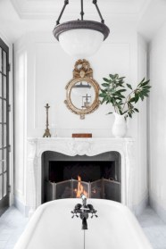 Astonishing and cozy bathrooms design ideas with fireplace 34