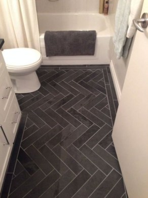 Elegant black herringbone tiles for your space 15