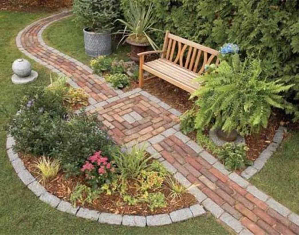 Small backyard area with seat and flowers decoration