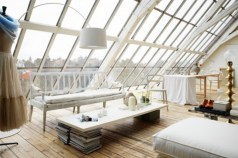 Vintage attic bedroom with wall of skylights03