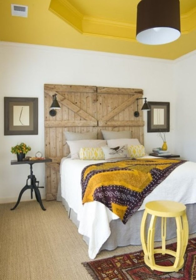 Vintage attic bedroom with wall of skylights06