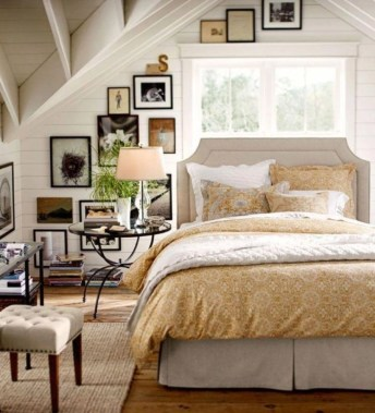 Vintage attic bedroom with wall of skylights18