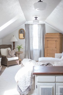 Vintage attic bedroom with wall of skylights19