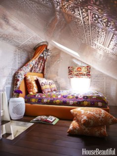 Vintage attic bedroom with wall of skylights20