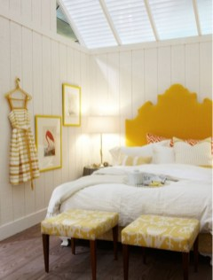 Vintage attic bedroom with wall of skylights21