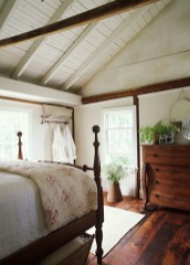Vintage attic bedroom with wall of skylights42
