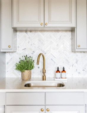 Adorable marble herringbone backsplash detail 03