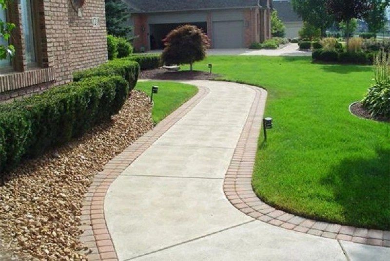 oncrete walkway with brick edging