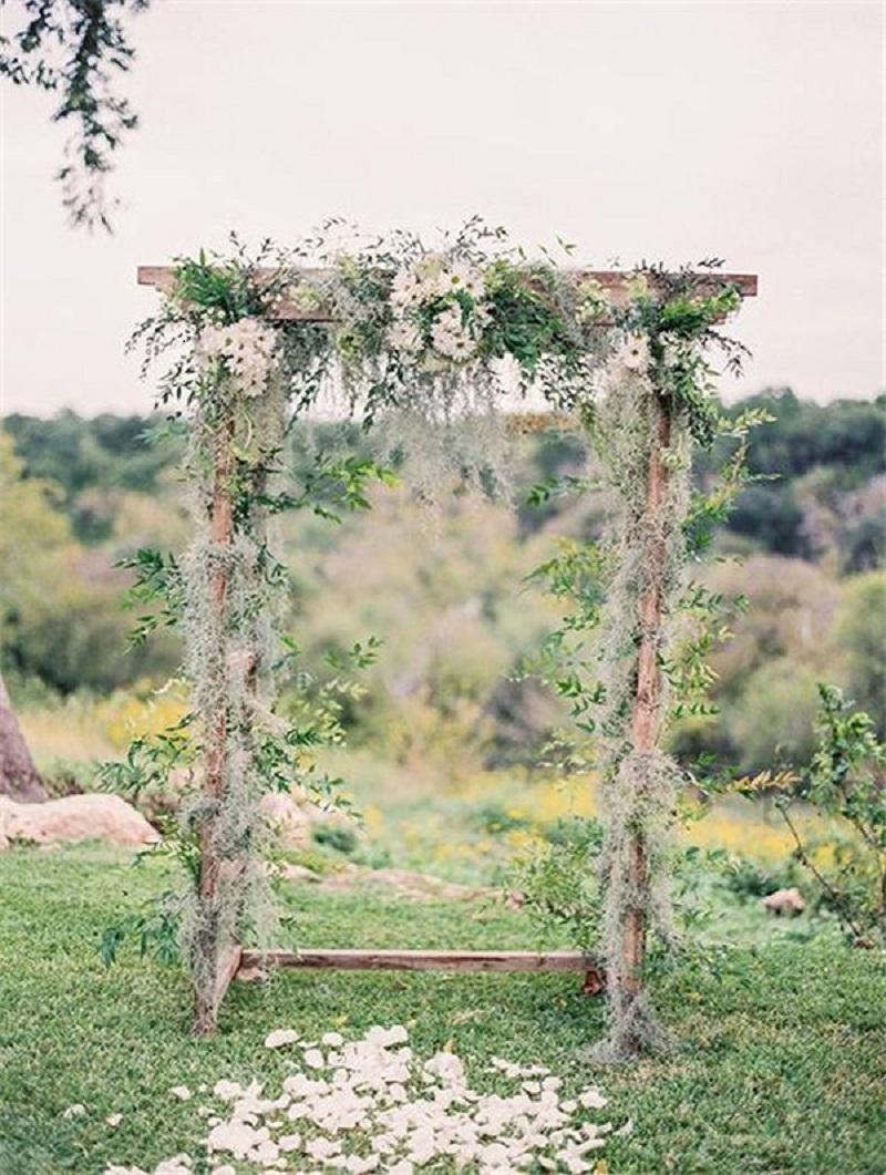 Bohemian wedding arbor with daisies arch