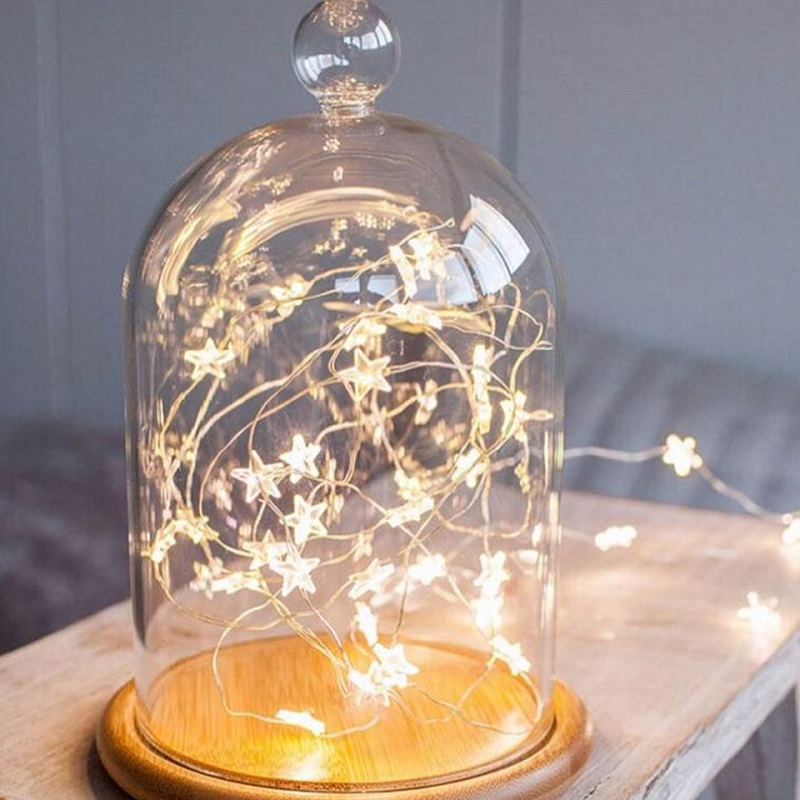 glass cloche with stars lights