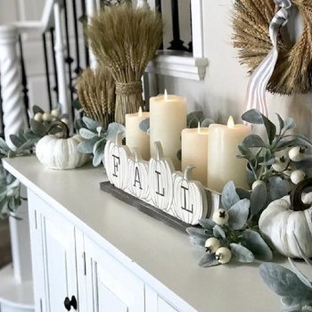 With an arrangement of candles