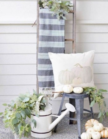 Neutral fall decor with a ladder