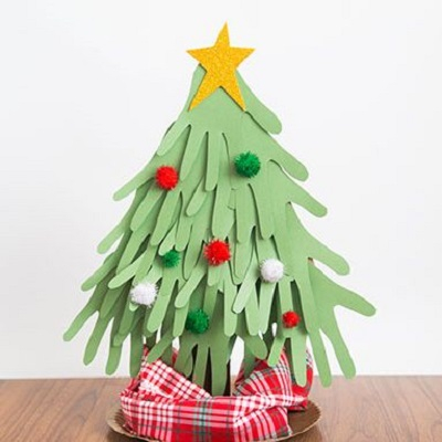 Handprint christmas tree Delightful Christmas Handprint Crafts That Anyone Will Keep Forever