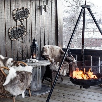 Terrace with large suspended fire bowl Enjoyable Terrace Décor Ideas To Create This Winter To Stay Comfortable